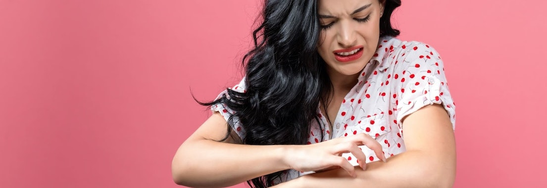 Woman looking at fungal infection on her arm Not Sure What's on Your Skin? It Could Be a Fungal Infection