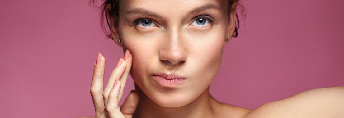 Woman applying acne treatment Over-the-Counter Acne Treatments Not Working? Try These Cosmetic Dermatology Services