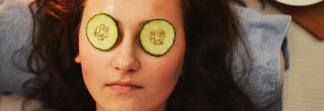 Woman with cucumbers over her eyes The Top 3 Minimally Invasive Skin Procedures