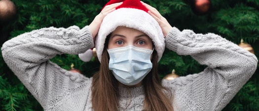Girl wearing a coronavirus mask and Christmas hat Enjoy a Chemical Peel to Get Rid of Signs of Holiday Stress