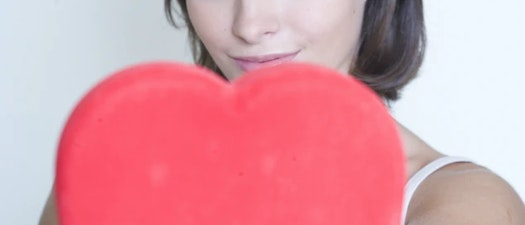 Woman holding a plush heart Try Lip Enhancement in Time for Valentine's Day