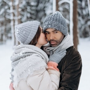 Man and woman hugging in the snow Why a Phototherapy Session Is Perfect in the Winter