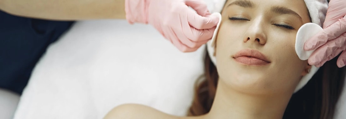 Woman receiving facial skin treatment What Are the Best Post-Winter Facials?