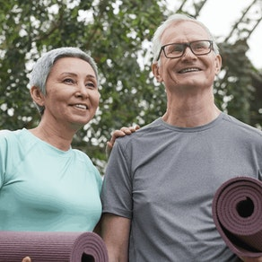 Older couple doing yoga to slow aging Is It Ever Too Late to Stop Aging?