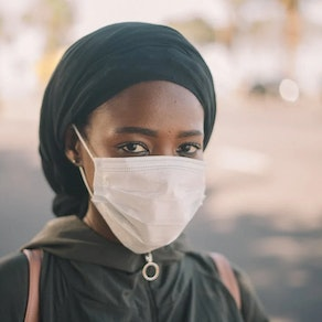 Woman with mask on in the winter How to Keep Eczema at Bay During a Twindemic
