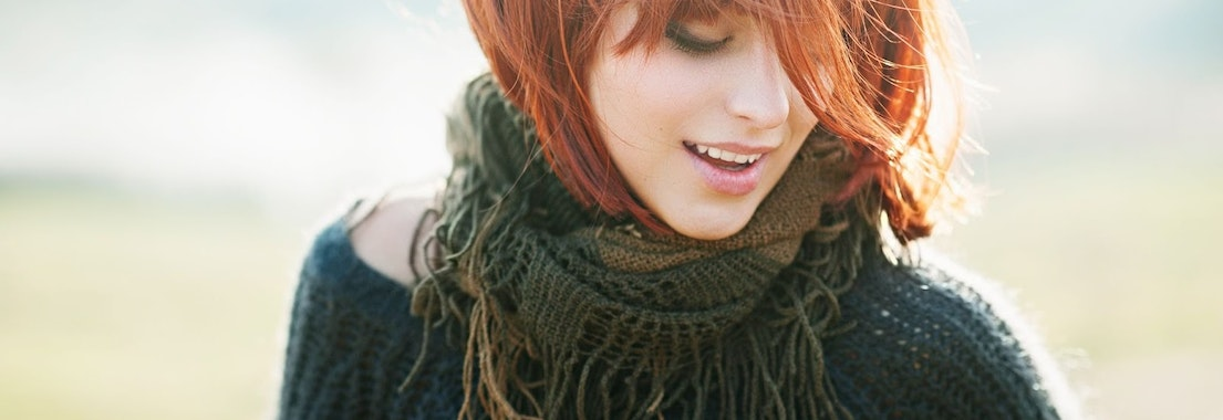Woman smiling outdoors Top Ideas to Make Your National Skin Care Awareness Month Even Better