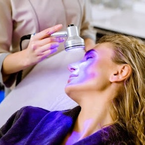 Light therapy on a woman's face What You Need to Know About Light Therapy