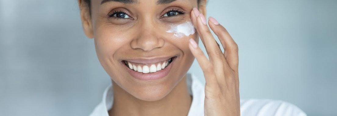 Woman applying cream for aging to her face How to Know Whether or Not You're Aging Well
