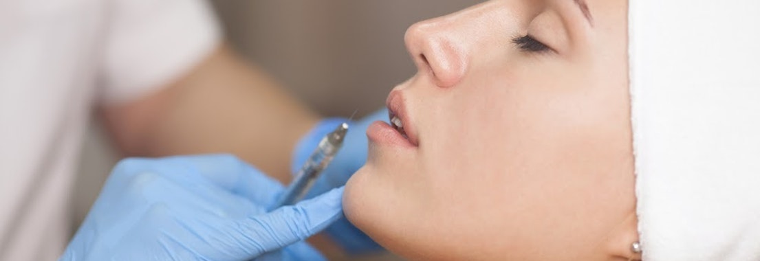 Woman having dermal filler treatment How Not to Overdo Botox and Fillers