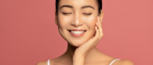 Woman with eye cream on her face How to Find the Perfect Eye Cream