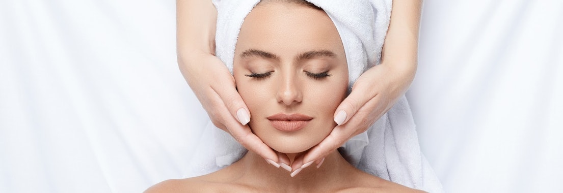 Woman receiving destressing facial skin treatment De-stress Pre-holiday With These Facials That Allow You to Relax