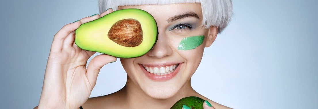 Woman with avocado facial treatment How Eating Fruits and Veggies Rejuvenates Your Skin