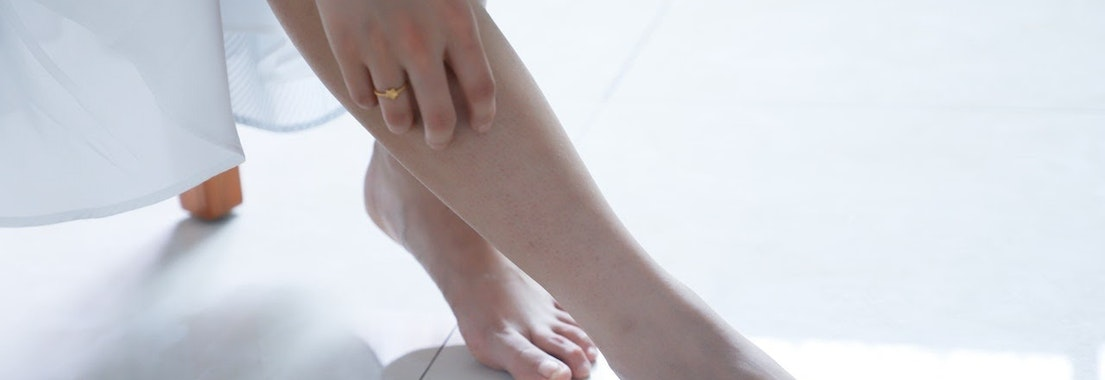 Woman checking leg for fungal infection Not Sure What's on Your Skin? It Could Be a Fungal Infection