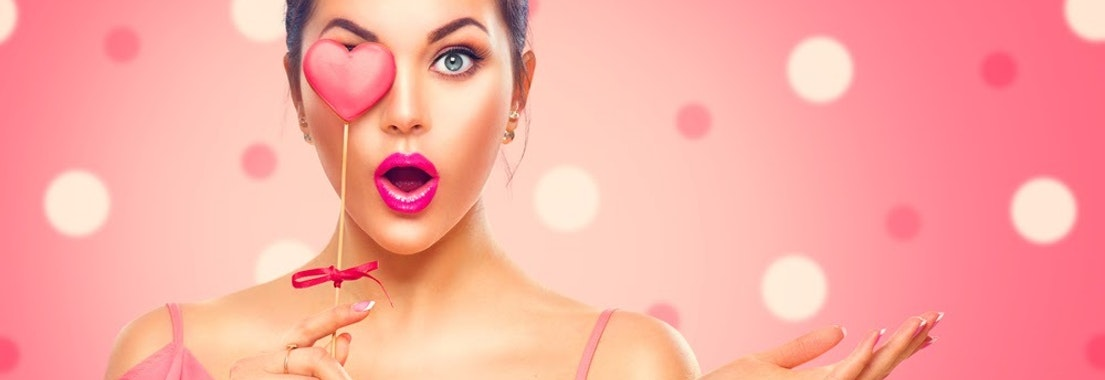 Woman with a toy heart over her eye Try Lip Enhancement in Time for Valentine's Day