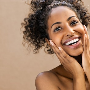 Woman feeling her clear skin Top Ideas to Make Your National Skin Care Awareness Month Even Better