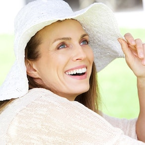 Woman smiling with sun hat Top Tips on How to Age Gracefully Without Looking Plastic