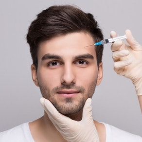 Man having dermal filler injection How to Invest in Fillers Without Anyone Noticing