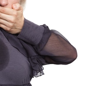 Woman embarrased by armpit sweat stain Public Speaker? Don't Let Sweat Stains Distract Your Audience