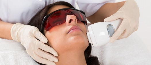Woman having Dermal Optical Thermolysis treatment How Dermal Optical Thermolysis (DOT) Therapy Can Help Your Skin This Winter