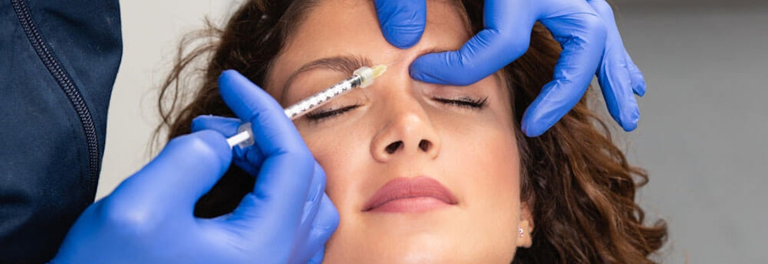 Doctor giving a woman botox Cosmetic Dermatology: Getting Better Results from Botox