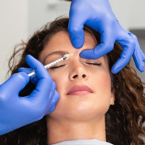 Woman having Botox above her eye Cosmetic Dermatology: How to Use Botox for Wrinkle Prevention