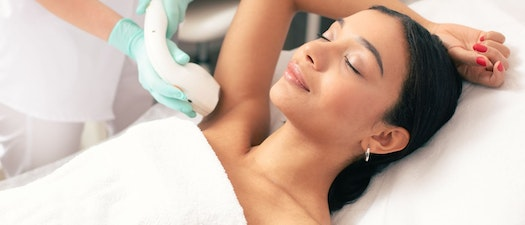 Woman having laser hair removal on her armpit Don't Worry About Body Hair During the Holidays. Try Laser Hair Removal.