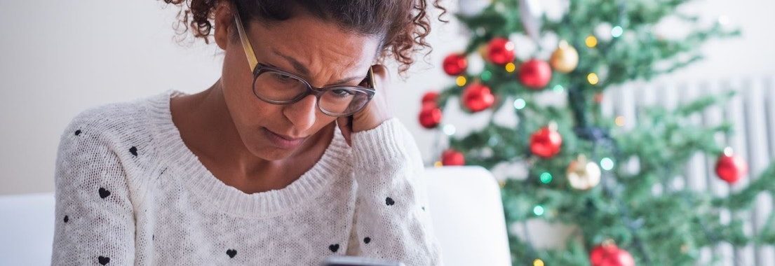 Woman scratching skin from holiday stress Can Holiday Stress Really Change My Skin?
