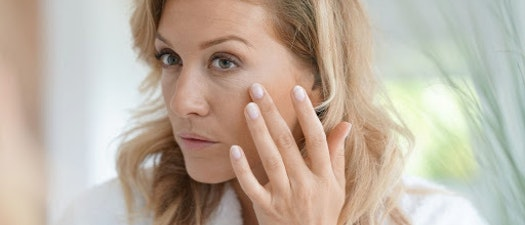 Woman feeling wrinkles on her face What Is Intense Pulsed Light and How Can it Help Your Skin?
