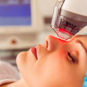Person having laser hair removal treatment Laser Therapy: From Stretch Marks to Tattoo Removal