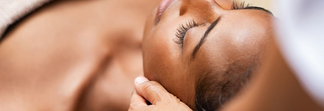 Woman having a facial skin treatment Look Your Best This Season with a Fall Acne Facial