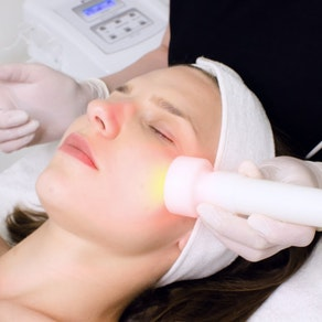 Doctor applying phototherapy treatment Why a Phototherapy Session Is Perfect in the Winter