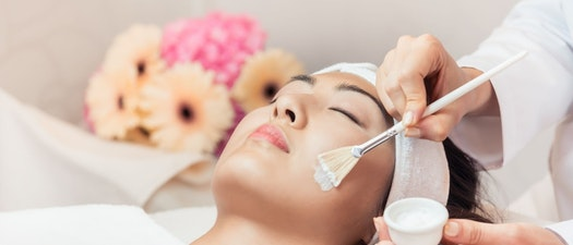 Woman having a facial treatment De-Stress Pre-Holiday with These Facials That Help You Relax