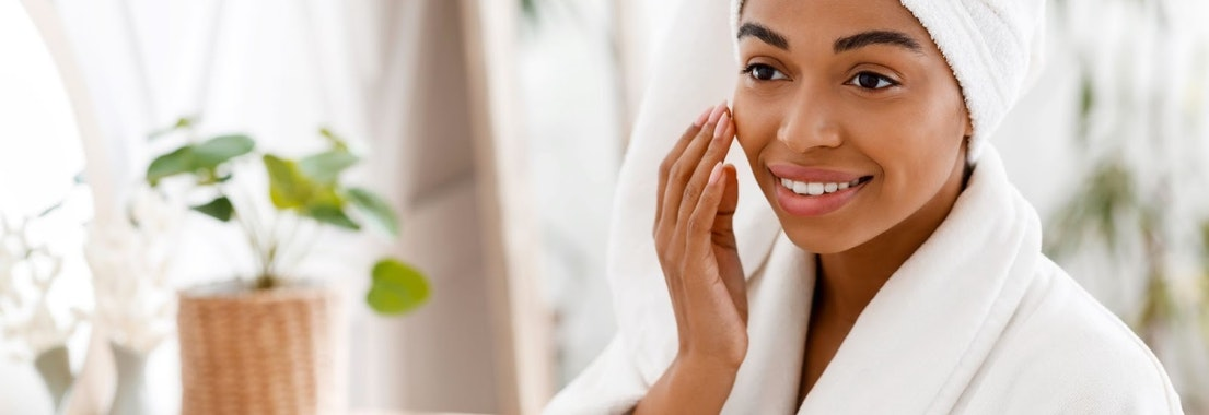 Woman smiling after using natural skin products What Natural Products Are Good for the Skin and What Can Hurt