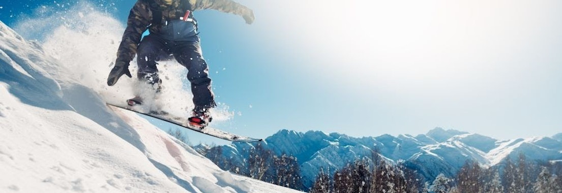 Person snowboarding in winter How to Enjoy Winter Sports and Help Your Skin