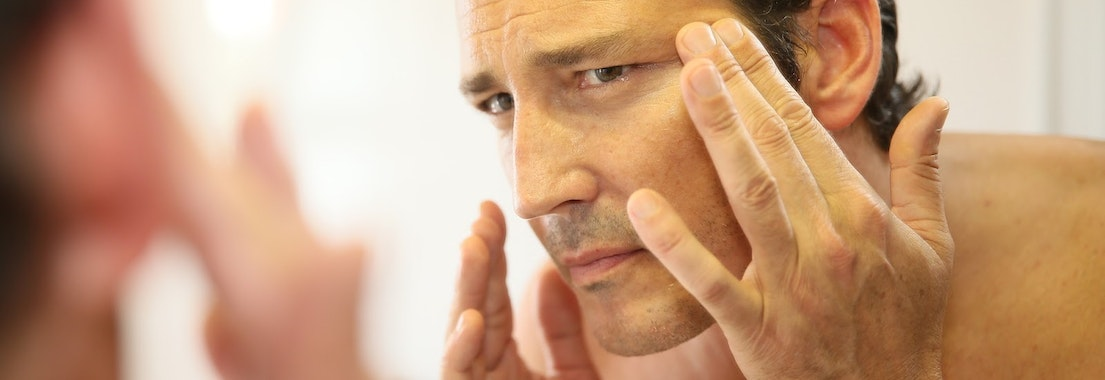 Man applying treatment to his face How to Address Skin Issues Every Decade