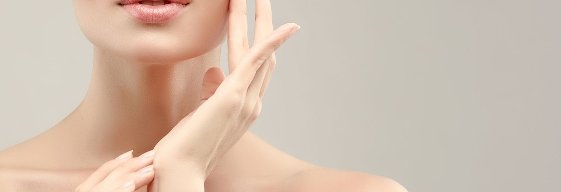 Woman feeling her face after skin treatment Why Fraxel Re:pair Is an Excellent Option for Skincare