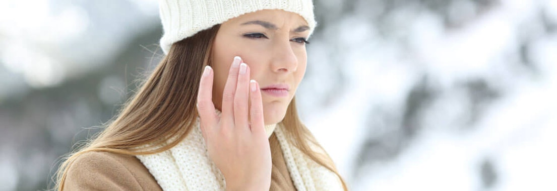 Woman feeling her dehydrated facial skin Do You Have Dehydrated Skin?