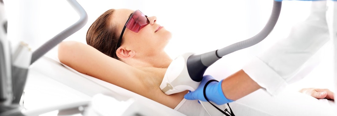 Woman having laser treatment on pigmentation Unwanted Pigmentation? Enjoy Clear Skin with Laser Treatments