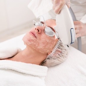 Woman having phototherapy on her face Why a Phototherapy Session Is Perfect in the Winter
