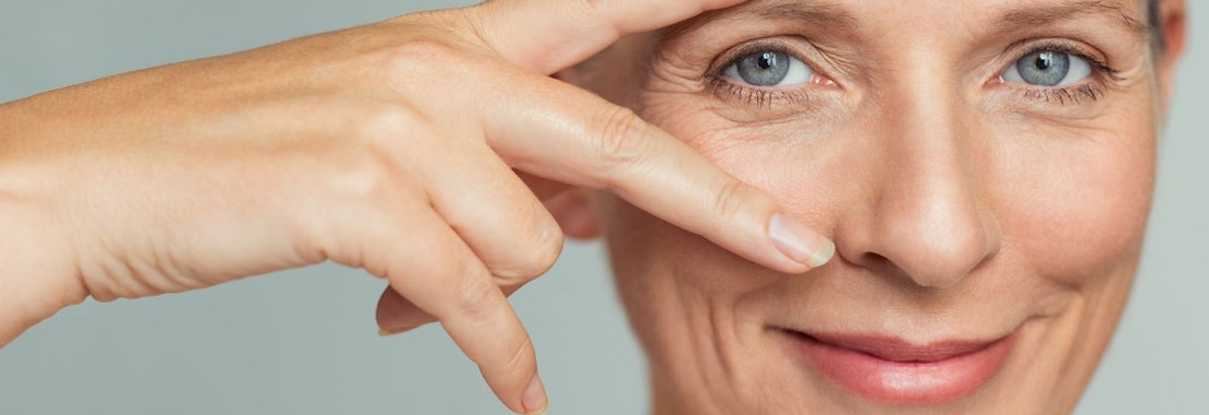 Woman looking at her skin for wrinkles How Can I Reduce My Wrinkles Before They're an Issue?