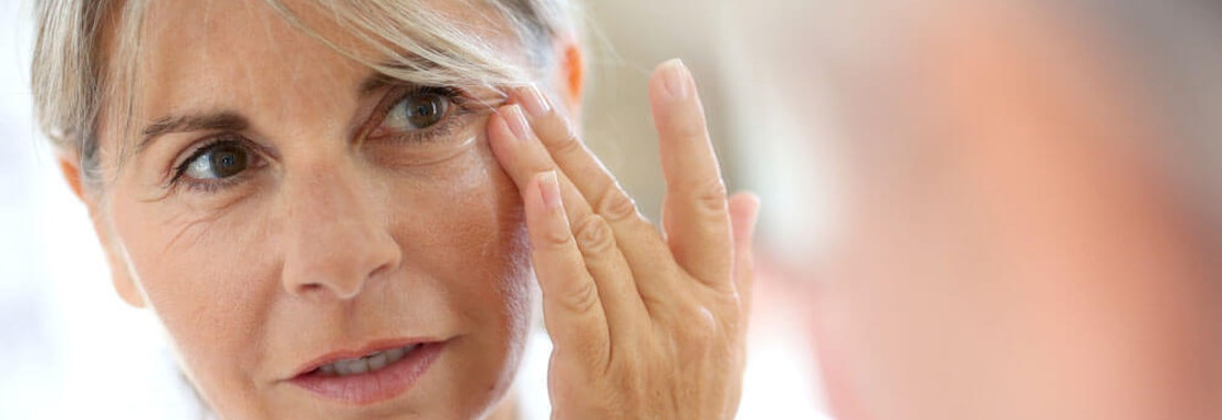 Woman treating her Crow's Feet The Best Treatment Options for Crow's Feet