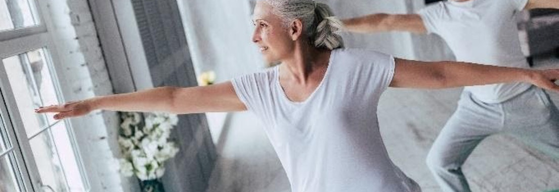 Older woman doing yoga What Shingles Can Do to Mature Generations