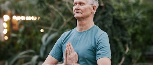 Older man meditating What Shingles Can Do to Mature Generations