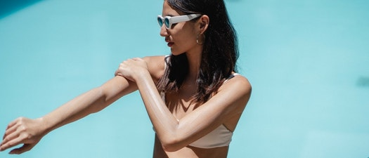 Woman applying sunscreen for skin care Top Ideas to Make Your National Skin Cancer Awareness Month Even Better