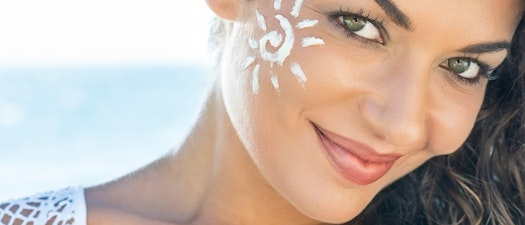 Woman with facial sunscreen Find the Perfect Facial Sunscreen Before Summer. Here's How