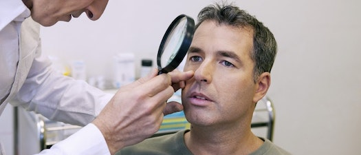 Doctor looking at someone's face Be Better to Your Skin This Skin Cancer Awareness Month. Here's How