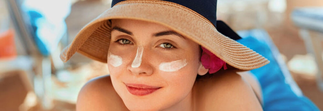 Vanguard Dermatology woman wearing sunscreen Skin Cancer Awareness Month: How You Can Protect Yourself